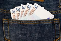 Euro money in jeans pocket. Euro money in blue jeans pocket Royalty Free Stock Photography