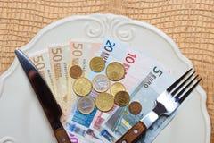 Euro money on kitchen table, coast of living Stock Photo