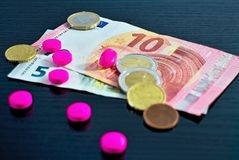 Euro money and medicaments. Eurocoins and pills. Medicinal product and treatment concept, pills tablets with cash. Currency, Pharmacy, Paper Currency, Traffic Royalty Free Stock Photo