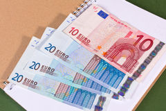 Euro money in notebook Royalty Free Stock Photo