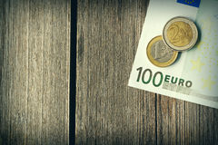 Euro money over wooden background Royalty Free Stock Photos
