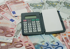 Euro money paper and calculator Stock Images
