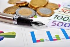 Euro money and pen Stock Photo