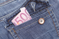 Euro money in a pocket of jeans. Jeans pocket with money close-up  isolated on white Stock Photos