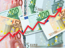 Euro money raise concept. Arrow chart pointing up against background of Euro bills Stock Images
