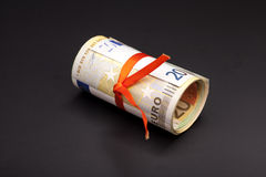 Euro money in a red ribbon Royalty Free Stock Image