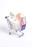 Euro money in the shopping cart Royalty Free Stock Photo
