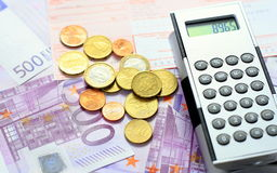 Euro money and slip. Euro money and sales slip with calculator Stock Photography