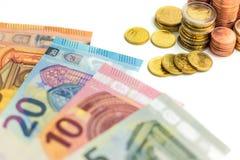Euro Money Stacks and Bills. On White Background Royalty Free Stock Photos