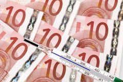 Euro money and thermometer Stock Photography