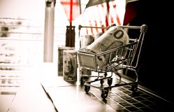 EURO money in trolley on laptop keyboard. Idea of exchange money. Online shopping, Online shopping is form of e-commerce, consumers to buy goods from directly Stock Photo