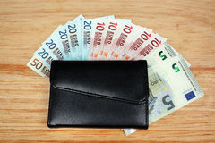 Euro money and wallet Stock Image