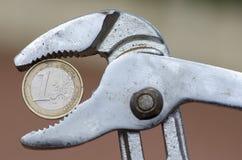 Euro munt onder druk Royalty-vrije Stock Afbeeldingen