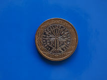 1 euro muntstuk, Europese Unie, Frankrijk over blauw Stock Afbeeldingen