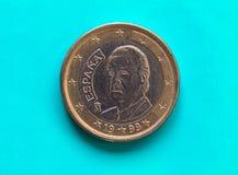 1 euro muntstuk, Europese Unie, Spanje over groenachtig blauw Stock Foto
