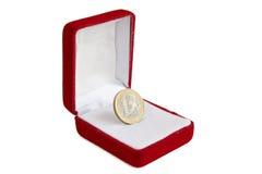 Euro muntstuk in juwelendoos Stock Fotografie