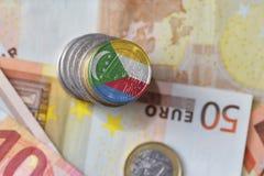 Euro muntstuk met nationale vlag van de Comoren op de euro achtergrond van geldbankbiljetten Royalty-vrije Stock Afbeeldingen