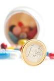Euro muntstuk voor witte container Royalty-vrije Stock Afbeeldingen
