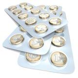 Euro muntstukken in blaarpak Stock Afbeeldingen
