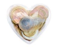 Euro muntstukken in de doos van het liefdehart Stock Foto's