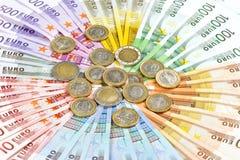 Euro muntstukken en bankbiljetten De Achtergrond van het geld Stock Afbeelding
