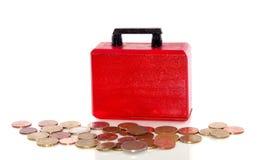 Euro muntstukken en een aktentas Stock Afbeelding