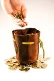 Euro muntstukken en zak Stock Foto's