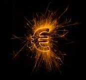Euro muntteken in vonken Stock Afbeelding
