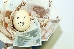 Euro nest egg. An image of an egg in a Euro currency nest basket royalty free stock photos