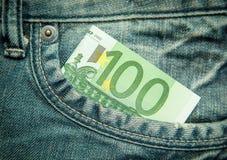 euro 100 no bolso das calças de brim Imagem de Stock Royalty Free