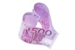 Euro- nota de banco em uma forma do coração Fotografia de Stock