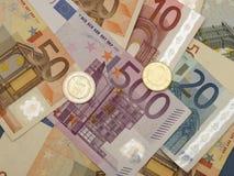 Euro nota's en muntstukken Stock Afbeeldingen