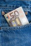 Euro nota in una casella delle blue jeans Fotografia Stock Libera da Diritti