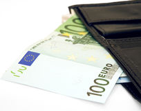 Euro note. 100 EURO bill and black wallet on white background Royalty Free Stock Photo