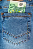 100 euro note in a blue jeans pocket. Financial concept Royalty Free Stock Photography