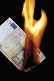 50 euro note burning against black background Royalty Free Stock Photos