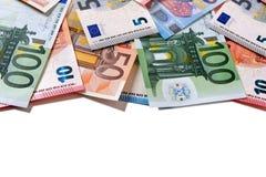 Euro note dei soldi del confine superiore su bianco Fotografia Stock Libera da Diritti