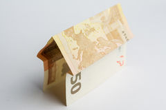 Euro note fold as house. Euro banknote fold as house Royalty Free Stock Images