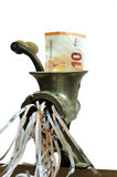Euro note in a meat grinder. 10 Euro note in a meat mincer in a conceptual photograph Stock Photography
