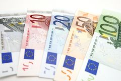 Euro notes. Background with different euro notes from five to one hundred royalty free stock images