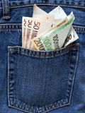 Euro notes in the back pocket of a blue jeans. Royalty Free Stock Images