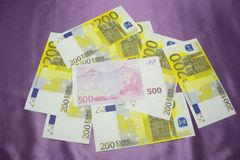 200, 500 Euro notes background texture - mingled pile.  Royalty Free Stock Photo