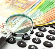 Euro Notes with calculator and magnifier Royalty Free Stock Image