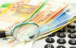 Euro Notes with calculator and magnifier Stock Images