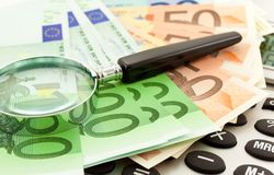 Euro Notes with calculator and magnifier Royalty Free Stock Photo