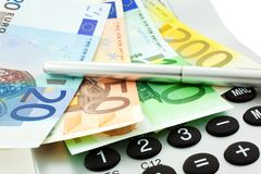 Euro notes with calculator and pen Stock Photography