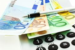 Euro Notes with Calculator and pen Royalty Free Stock Photo