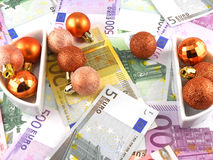 Euro notes with christmas balls on it Royalty Free Stock Image