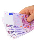 Euro notes (clipping path). Male hand holding five 500 euro notes isolated on white with clipping path Royalty Free Stock Image