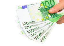 Euro notes (clipping path). Male hand holding six 100 euro notes isolated on white with clipping path Stock Images